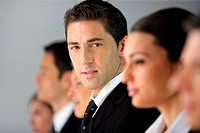Businesspeople sat in a row