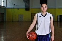 one healthy young man play basketball game in school gym indoor relax