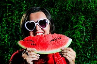 funny fashion happy woman with heart shape heart and watermelon
