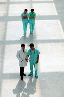 Hospital staff walking down corridor