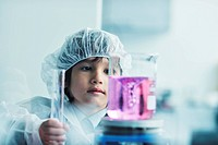 cute little male child have experiment with test tubes in bright modern lab