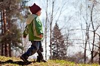 Child walking forest
