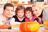 Family carving pumpkins