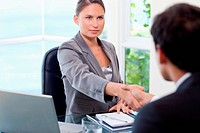 Businesswoman shaking hands with customer