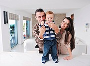 happy young family have fun and relaxing at new home with bright furniture