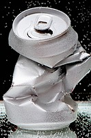 Crumpled beverage can with bubbles