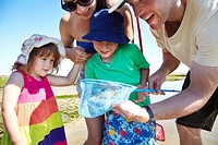 Family fishing with nets outdoors