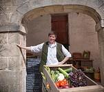 Farmer wheeling cart of vegetables