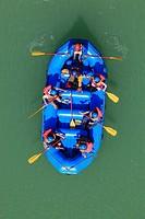 India, Uttarakhand, Rishikesh, People in rafting boat at River Ganges