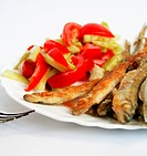 Fish _smelt in flour crust appetizer with salad on the plate