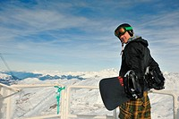 happy young man have fan while relaxing at snow with ski and snowboard sport at winter season