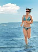 The girl running on seacoast
