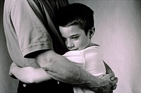 Son hugging father