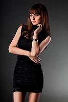 beautiful fashionable woman on grey background