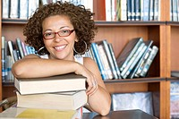 Smiling Hispanic woman in library