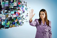 Businesswoman holding hand out toward digital images