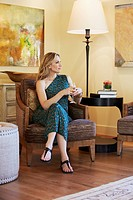 Woman sitting in chair drinking wine