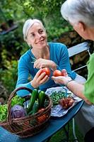 Senior couple preparing vegetables.