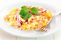Scrambled eggs with ham and onion