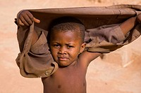 Torodi, Niger: July 12, 2007. A young boy walks the streets of his West African hometown.