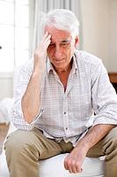 Man suffering from headache.
