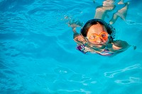 Girl and swimming in pool