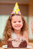Slice of cake in front of girl