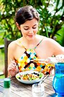 Woman eating a mediterranean salad.