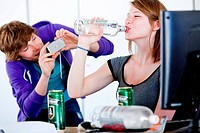 Teenagers taking pictures each others during a binge drinking.