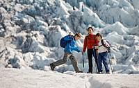 Family walking on glacier