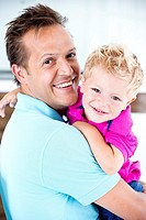 Germany, Father carrying son, smiling
