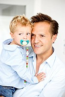 Germany, Son carrying pacifier, close_up