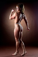 strong woman body builder walk side