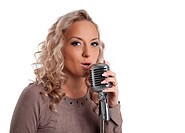 Blonde woman with vintage microphone