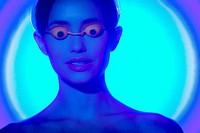 Woman using a tanning UV sunbed in a beauty institute, and wearing UV protection glasses.