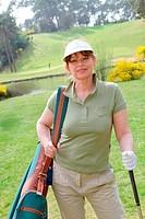 Portrait of senior woman on golf course