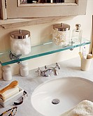 Close up view of sink with toiletries kept around it