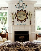 A black and white decorated library accented with turquoise