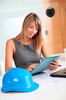 Blond woman architect working in office