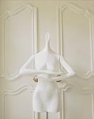 Mannequin in Front of Doors