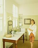 Nathalie du Luart Standing by Table Used as Bathroom Vanity