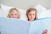 Brother and sister reading bedtime story