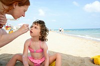 Daughter and mother on the beach sun screen moisture