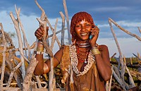 Turmi Ethiopia Africa Lower Omo Valley village with Bena tribe First Wife smiling with jewelry in wild wood camp hut 24