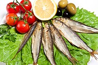 smoked fish served with tomato fennel and olive