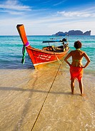 Young woman relaxing  Long beach  Phi Phi Don island  Krabi province, Andaman Sea, Thailand