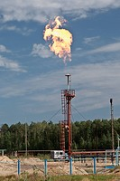 Gas flame on background blue sky