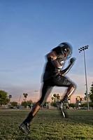 Running African American football player