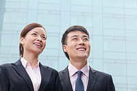 Smiling Chinese business people
