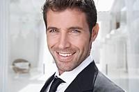 Spain, Businessman smiling, portrait